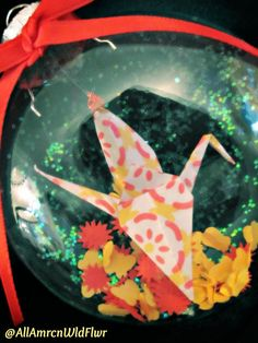 Origami Crane Glass Christmas Ornament in red and yellow, by AmrcnWldFlwrDesigns on Etsy, $12.00