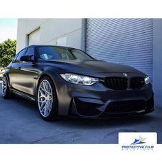 Stunning BMW wrapped in Avery Dennison SW 900 Satin Pearl Nero by Protective Film Solutions, protectivefilmsolutions.com