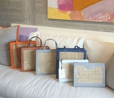 A selection of our fabulous rattan and leather bags. Available at oomph Greenwich.