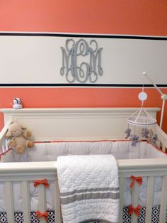 Coral & navy is such a hot color combo for the nursery this year! Love this clean design + monogram. #nursery