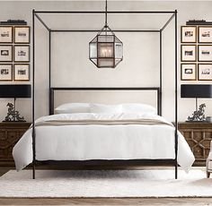 RH's 19th C. French Iron Four-Posted Bed:Commissioned by military officers to make life on the march as gracious as life at home, French campaign furniture merged elegant design with rugged portability. This canopy bed echoes the style of its 18th- and 19th-century predecessors with a linear silhouette, slender posts and an unadorned headboard.