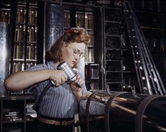 Photography from WWII Aircraft Assembly. In World War II, the floors of aircraft manufacturing plants were dominated by women.