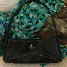 Purse Great used condition. I can't find anything saying wether this is leather or man made. I've owned it for years. I think it's leather but not sure.  Mick-Gwend Paris Bags Mini Bags