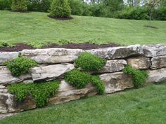 boulder meets timber retaining wall - Google Search Architectural Landscape Design
