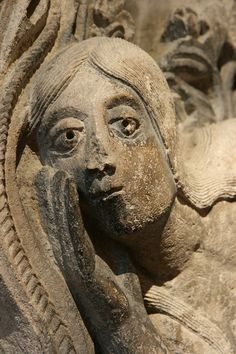 The Temptation of Eve (detail) by Romanesque master sculptor Gislebertus via Art History Images.