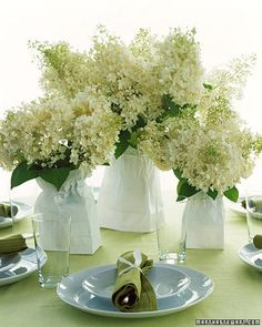 Floral Arrangements in Bags - or same arrangement with floral tree branches in mason jars