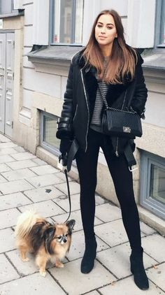 Kenza Zouiten + keeps it smart casual + gorgeous monochrome style + striped tee + shearling suede jacket + pair of simple leggings + cross body bag + Kenza's style. Jacket: Acne Studios, Tights: Ginatricot, Sweater: Make Way, Bag: Chanel, Boots: Anine Bing.