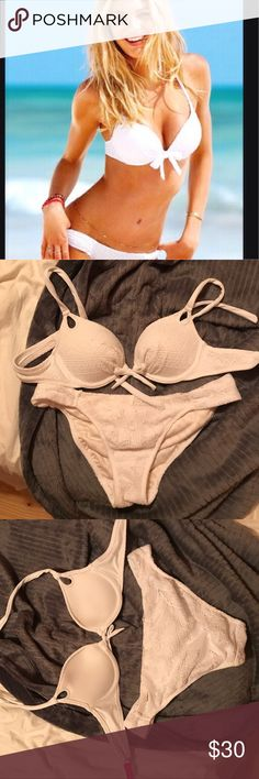 White lace crotchet push up bikini VS 34A medium Worn once in a hot tub perfect condition , original white lace set with the VS imprinted inside the bottoms and the little openings to the halter top that are really simple but adorable features. Great go to bikini. I just have to many and don't go to beach/pool enough! Victoria's Secret Swim Bikinis
