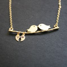 For my little A & E?  Love Bird Necklace Custom Initial Leaf Gold by JewelryDeli on Etsy