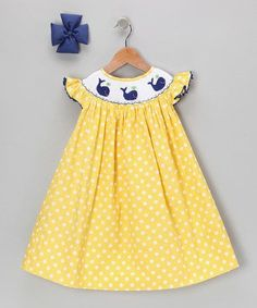 Boasting a light, breezy construction and back buttons, this timeless silhouette slips on for sweetness in seconds. Angel sleeves and smocking give it additional charm, while a coordinated bow finishes the look like a cherry on top! Kids Outfits Girls, Girl Outfits, Little Girl Dresses, Girls Dresses, Toddler Dress, Infant Toddler, Toddler Girls, Baby Dress Design, Baby Dress Patterns