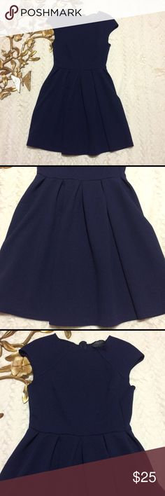 """Romeo & Juliet Couture Navy Dress Romeo & Juliet Couture Small Navy Dress with Full Pleated Skirt measurements taken laying flat: 32"""" length from shoulder 12"""" waist 14"""" bust Romeo & Juliet Couture Dresses Midi"""