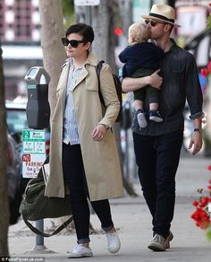 Doting parents: Ginnifer Goodwin and husband Josh Dallas were spotted shopping in West Hollywood with son Oliver on Friday