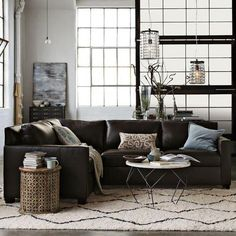 loft, living room is awsome in black and white ! I love the brown sofa !
