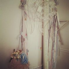 Love this! Wire angel wings (nice for a heart too) - lace, fabric strips ( nice girly dreamcather )