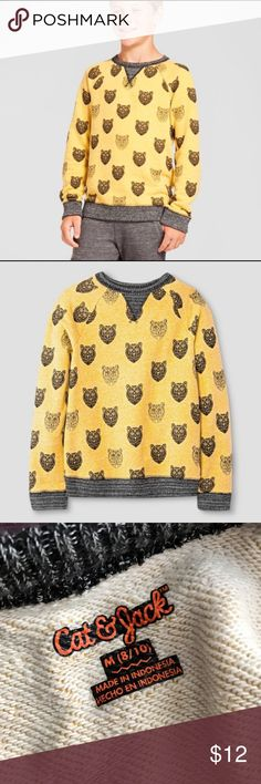 Boys Bear Gold Pullover Cat & Jack Very cute golden sweatshirt pullover! It was too tight a fit for me (will probably be getting a Large), but it could work for someone smaller. Been worn twice. 68% cotton, 27% polyester, 5% rayon. Cat & Jack Shirts & Tops Sweatshirts & Hoodies