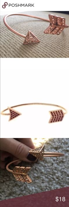 House of Harlow Rose Gold Arrow Cuff Bracelet House of Harlow Arrow Bracelet  Rose Gold with Rose Gold Swarovski Crystals This bracelet is not shiny but rather matte/antique  The bracelet was bought as used on ebay for $44 1 year ago & I have used it a couple of times.  All the crystals are intact.  The bracelet is no longer new so I am pricing it accordingly.  Please look at pictures closely.  Not sure what material it is as I can't find the description anywhere online.   Will send this in…