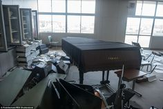 A trashed piano and musical instruments lie on the floor after residents were evacuated following the Fukushima nuclear disaster