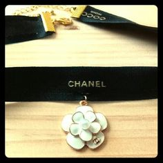 LUXURY BRAND CHOKER Beautiful Handmade CHANEL Choker made with an Authentic & Rare Coco Noir Ribbon. I added a camelia flower with white enamel and gold plated with the Double C Logo.  This Choker will come with a Chanel perfume sample, Authentic Spatula for all your jar creams and a Chanel Makeup Card as seen in last pic. CHANEL Jewelry Necklaces