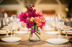 centerpiece option - orange and pink flowers mixed in a small vase