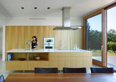Superkül extend farmhouse with rusty Corten-clad block.