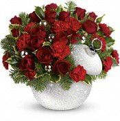 Sparkle and shine this holiday season! Red roses and miniature carnations are presented in our fabulous iridescent and silver-glitter-covered Shimmering Snow ornament jar.