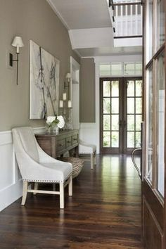 Love the natural wood french doors! Paint: Benjamin Moore Berkshire Beige.