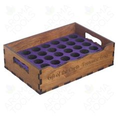 This nice-looking, sturdy wooden tray contains a foam insert for holding up to 36 vials, 5 to 15 ml in size.