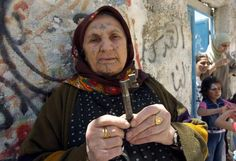 Many Palestinian refugees like this elderly woman from Deheishe refugee camp continue to hold keys to their homes and continue to hope and work for their right of return. They key of their homes of which they were expelled during the Nakba, have become a symbol for the Palestinian refugees – (Photo BADIL)