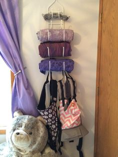 Wrap & carrier storage in Adeline's nursery