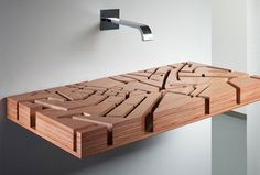 Water Map is a beautiful basin that uses topographic map designed as a water sink station. It is a wooden, three-dimensional, designer bathroom sink where the water flows through a maze of carved ducts.