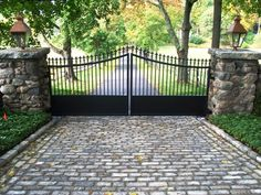 Automated Iron Driveway Gate- Simple design and like the solid portion on bottom (for keeping the dog in). Iron Gates Driveway, Driveway Entrance, Front Gates, Entrance Gates, Front Gate Design, Brick Columns, Driveway Landscaping, Wrought Iron Gates, Fence Gate