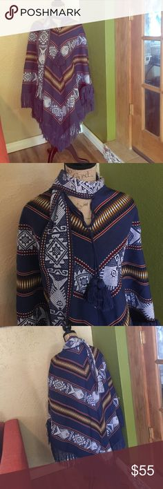 Vintage tribal fish poncho Very beautiful poncho with tassel ties and built on fish scarf. One size fits most Vintage Sweaters Shrugs & Ponchos