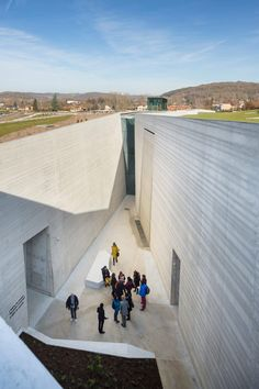 Long bands of glazing in the facade and roof allow slivers of light into the museum by Snøhetta and Casson Mann