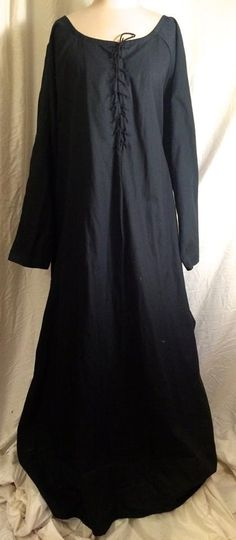 "Black Cotton Dress w/Front Lacing Bust 54"" Shoulder Width 21"" Arm 23"" Underarm to Hem 46"" Waist 60"" Hip 72"" $56 Consignment"