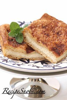 Super Easy - Sopapilla Cheesecake recipe from RecipeSnobs.com