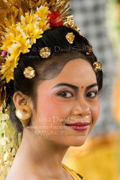 Close-up portrait of young Bali woman wearing traditonal costumes at Padang Bai, Bali, Indonesia, Asia