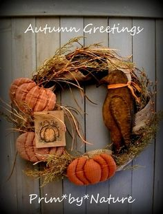 "Primitive Autumn Wreath with a black crow nestled among 3 pumpkins made out of differing checked fabrics in gorgeous fall colors with real twigs for stems. I wrapped the wreath in burlap tucked in bunches of preserved Sweet Annie, some feathery fillers, and some orange pip berries- I finished it off with a hand-colored pumpkin tag that reads ""Welcome Autumn"""
