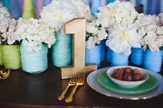 DIY Wedding Ideas / Rainbow Wedding ~ DIY Yarn Wrapped Vases on http://itsabrideslife.com