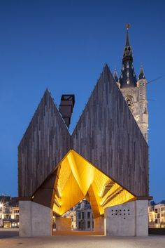 Market Hall in Ghent - this modern open construction is located in the city centre of Ghent, with the beautiful Belfort behind it.