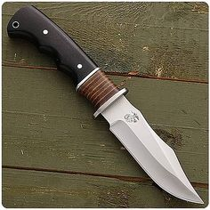 The Leather Neck C2 knife is a field folder with a retro, leather USMC insert.