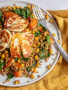 Fried Halloumi with Roast Carrot and Chickpea Couscous   Grilled halloumi is served on top of couscous mixed with roasted chickpeas, carrots and kale. This simple weeknight dinner is easy to make and suitable for vegetarians!   elizabethchloe.com   #halloumi #halloumireciepes #Couscous #couscoussalad #couscousrecipe #roastcarrots #carrots #vegetarian #vegetariandinner #vegetarianrecipes #vegetarianrecipe #elizabethchloerecipes