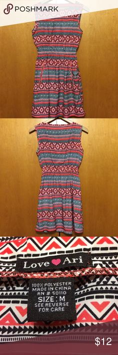 Aztec Print Dress Cute dress in pinkish-coral, black and white tribal print. Slightly high neckline. Elastic waist. Pockets. No flaws. love ari Dresses Mini