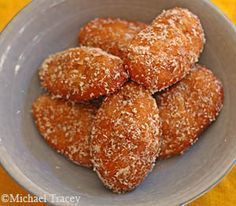 South African style:-) Cape Town way.Cape Malay Koeksisters, boiled in syrup and rolled in coconut, deliciously spicy. South African Desserts, South African Dishes, South African Recipes, Indian Food Recipes, Donut Recipes, Baking Recipes, Dessert Recipes, Baking Ideas, Pie Recipes