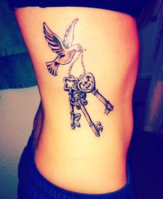 Keys dove rib tattoo for girls.