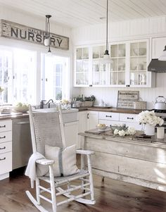a rocking chair in the kitchen...in a beautiful kitchen, actually.  i like that :)