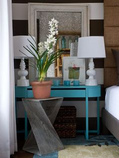 A brown demilune table, too tall for the pint-size space, was trimmed down and spray-painted a vivid shade of blue. Design from the 2012 HGTV Green Home.