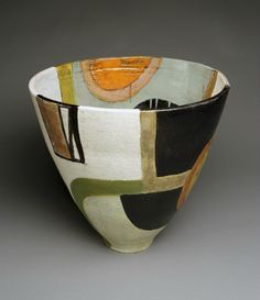 This bowl was shaped very uniquely, which is why I like it. The paint on this piece is also very abstract which is another reason why I like it.