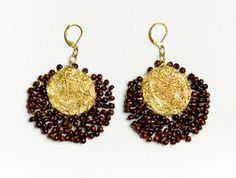 Intricate lace is a trend for seasons to come. These popular earrings feature tiny wooden beads that hang from a web of bronze.