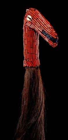 Flywhisk from Cameroon wood, beads, animal hair, wooden handle in form of a stylized animal (horse?), completely covered with blue and red beads, eyes inset with cowrie snails, min. dam. Read more: www.tribal-art-au...