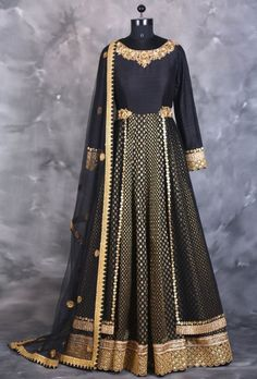 Black brocade net layered anarkali. COLOUR: Black SHIPPING & RETURNS - Product will be shipped within 4 weeks from the date of purchase. - This product qualifies for free shipping - Duty free shopping